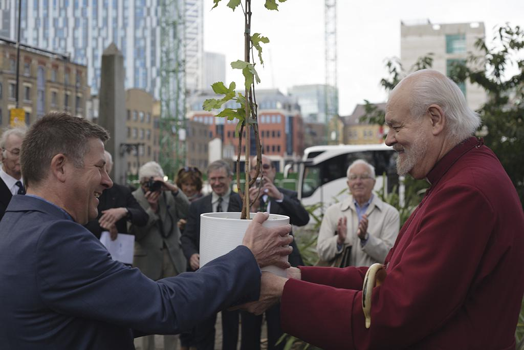 The Bishop of London presents the mulberry sapling to Rev. Andy Rider, Rector of Christ Church.