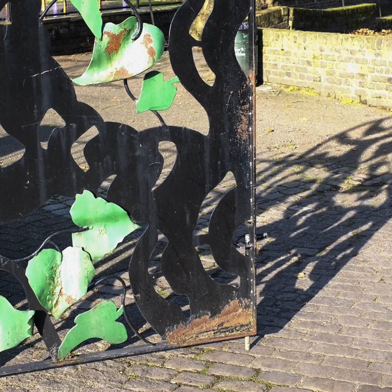Mulberry leaves on the iron gate into Sayes Court Park